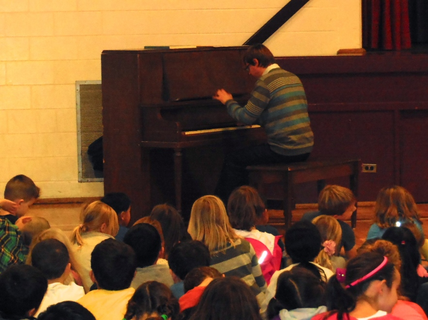 Sergei Saratovsky plays for a very appreciative audience at a local elementary school!