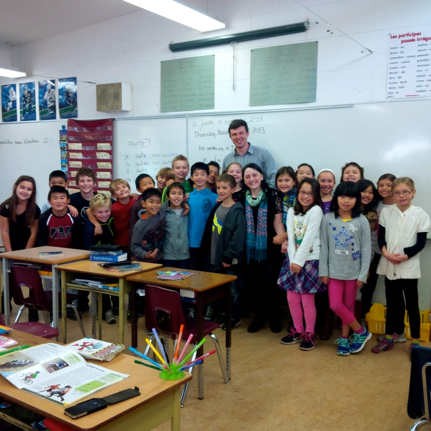 Totally inspired group of elementary school students after a wonderful outreach recital by Alex Karpeyev.