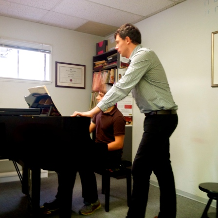 Alexander Karpeyev works with a student on the first movement of a Beethoven Sonata.