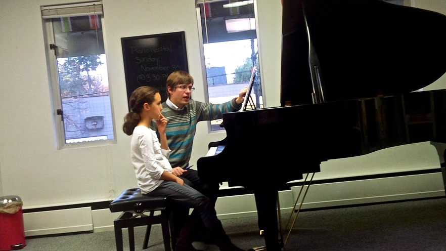 Dr. Saratovsky works through some Bach with a student.