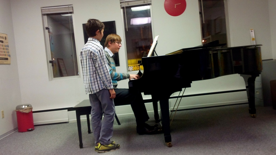 Dr. Saratovsky works with a young pianist after a stunning performance of Brahms, op. 117, no. 3.